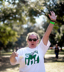 19 October 2014. New Orleans, Louisiana. <br /> The women's winner of the egg and spoon race at the New Orleans' Irish Network's third Family Day event with fun and games for kids and adults alike. With Irish dancing, egg and spoon and sack races with a good old fashioned tug of war to round things off.<br /> Photo; Charlie Varley/varleypix.com