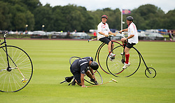 England (white shirts) compete against Scotland in the Penny Farthing International Polo match during the Bentley Motors Royal Windsor Cup Final at at Guards Polo Club, Windsor Great Park, Egham, Berkshire.