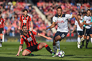 Tottenham Hotspur Midfielder, Moussa Dembele (19) tackles AFC Bournemouth Midfielder, Jack Wilshere (32) during the Premier League match between Bournemouth and Tottenham Hotspur at the Vitality Stadium, Bournemouth, England on 22 October 2016. Photo by Adam Rivers.