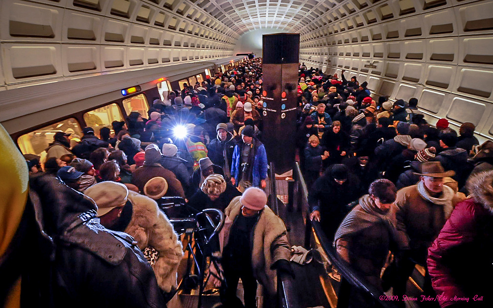 WASHINGTON, D.C. - JANUARY 20, 2009 - People ride the subway in the middle of the night to the U.S. Capitol. Hundreds of thousands, possibly the largest crowd ever assembled in the Nation's Capital, gather on the National Mall to celebrate the inauguration of Barack H. Obama as 44th, President of the United States. Inauguration-goers started to arrive and assemble the night before to find a position to watch on the Mall. <br /> Photography ©DONNA FISHER / The Morning Call