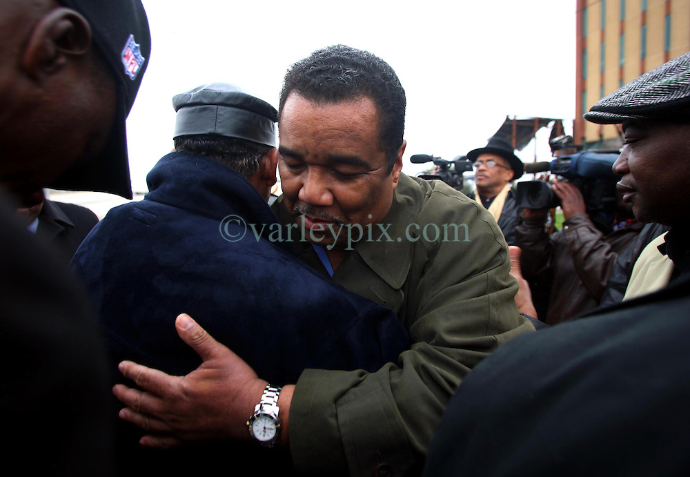 02 March 2010. New Orleans, Louisiana, USA. Danziger Brtidge..Reverend Dr Norwood Thompson Jr embraces Doctor Romell Madison, brother of victim Ronald Madison as they pray following  their address to the media. Civil Rights leaders gather at the notorious Danziger Bridge in New Orleans East, scene of the Sunday Sept 4th, 2005 murder of 40 yr old Ronald Madison and 19 yr old James Brissette by New Orleans police. .The police are under federal investigation for an alleged cover up of the botched killings in the chaotic aftermath of hurricane Katrina. .Photo; Charlie Varley.