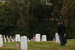 May 29, 2017 - San Bruno, California, U.S - MATEO SHULER, 8, stares at headstones at the Golden Gate National Cemetery on Memorial Day in San Bruno, California. (Credit Image: © Joel Angel Juarez via ZUMA Wire)