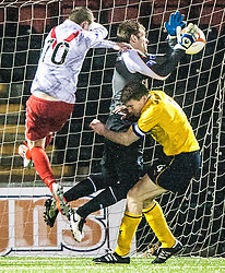 Falkirk's keeper Michael McGoverin the middle of Airdrie United's Ryan Donnelly and Falkirk's Darren Dods..Airdrie United 1 v 4 Falkirk, 22/12/2012..©Michael Schofield.