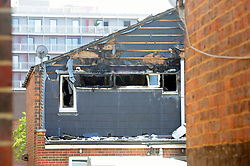 © Licensed to London News Pictures. 07/08/2018<br /> DEPTFORD, UK.<br /> Back of the property.<br /> 7 year old boy found dead after suspicious house fire at Adolphus Street, Deptford.   Arson investigation has been launched.<br /> Photo credit: Grant Falvey/LNP