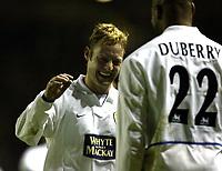 Photo. Aidan Ellis, Digitalsport<br /> Leeds United v Fulham.<br /> FA Barclaycard P{remiership.<br /> 14/12/2003.<br /> Leeds David Batty celebrates with scorer Michael Duberry