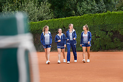 Young women walking on tennis court, Bavaria, Germany