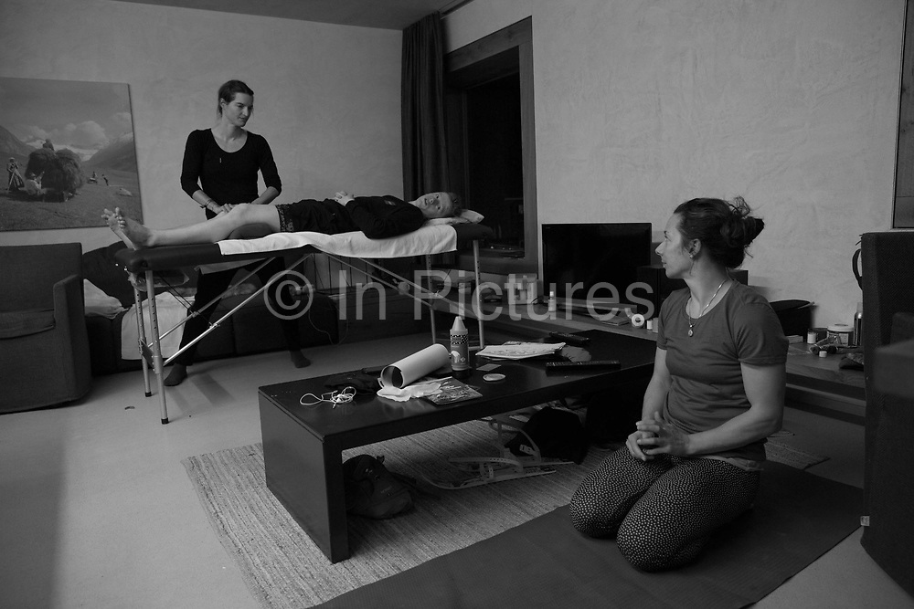Scottish Olympic freestyle snowboarder Matt McCormick undergoing routine physiotherapy with Lisa Filzmoser during the Laax Open on 19th January 2017 in Laax, Switzerland. The Laax Open is a FIS Snowboarding World Championship competition in Laax ski resort.