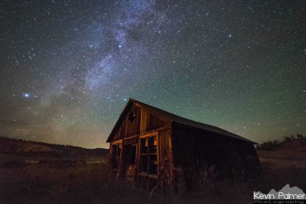 With fall off to such a cloudy start, I felt like I had to take advantage of the few hours of clear skies on this night. I ended up in a remote part of Montana, where the deer and coyotes vastly outnumber people. The dot on the map labeled Kirby is a ghost town. I couldn't find any information on what this old wooden building used to be. Perhaps it was a school, or a post office, or a general store. Or maybe it's better not to know, which makes it more mysterious. Frosty overgrown grass surrounded the leaning walls and crooked windows. The light from a distant ranch house (the only one in the area) was just enough to cast a warm glow on the front of the building.