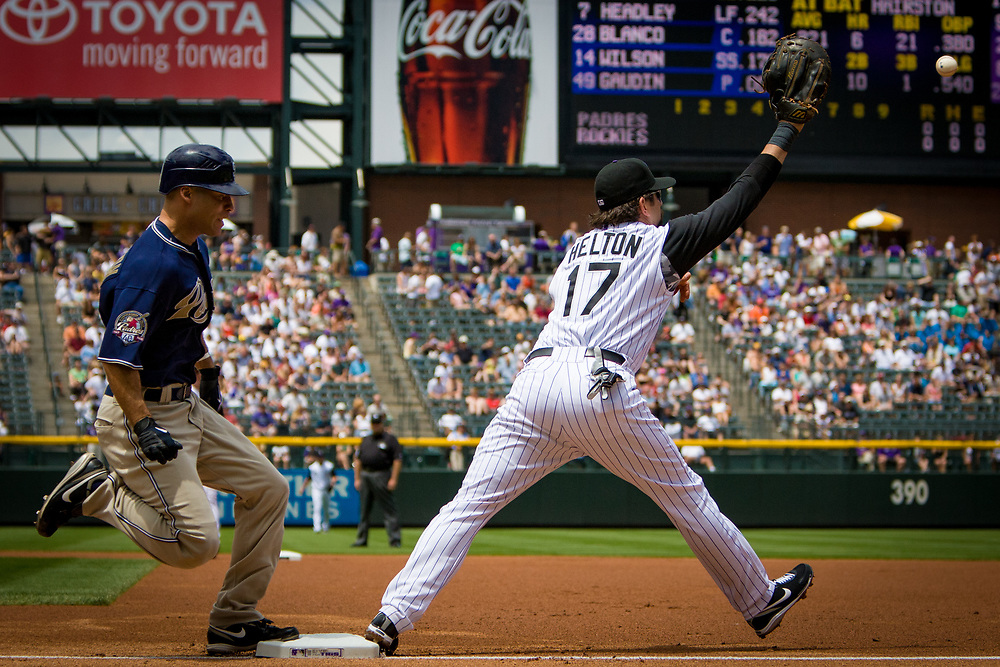 San Diego Padres outfielder SCOTT HAIRSTON reaches first with a single before Colorado Rockies first baseman TODD HELTON catches the throw.  The Padres beat the Rockies 5-2 at Coors Field.