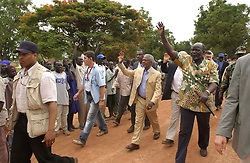 May 28, 2005; Rumbek, SUDAN; H.E. Dr. John Garang, (Chairman, Sudan People's Liberation Movement) and the SG, Kofi Annan walking down the street as the crowd welcomes the SG to Rumbek. Mandatory Credit: Photo by Evan Schneider/UN/ZUMA Press. (©) Copyright 2005 by Evan Schneider/UN