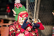 "05 DECEMBER 2020 - INDIANOLA, IOWA: A child dressed as a Christmas elf works on toys in ""Santa's Workshop"" during a drive through visit with Santa Claus. About 500 children visited Santa Claus and Mrs. Claus in Indianola Saturday. The town has hosted Santa on the town square for the last seven years but the COVID-19 (SARS-Cov-2) pandemic forced organizers to move the event to the parking lot of a local hardware store and do it ""drive through"" style. Iowa has one of the highest Coronavirus test rates in the United States.        PHOTO BY JACK KURTZ"