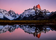 Dawn reflection in pond under Cerro Torre, (left) & FitzRoy, Los Glaciares National Park, Patagonia, Argentina