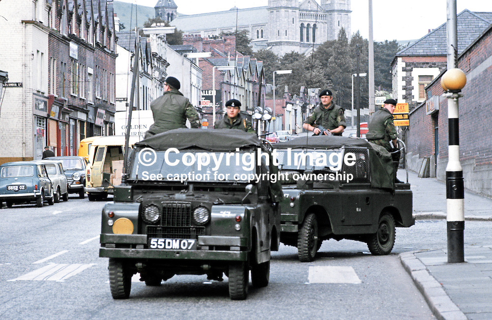 British army landrovers patrolling on the Crumlin Road, Belfast, N Ireland, September, 1971, 197109000431e.<br /> <br /> Copyright Image from Victor Patterson, Belfast, UK<br /> <br /> t: +44 28 9066 1296 (from Rep of Ireland 048 9066 1296)<br /> m: +44 7802 353836<br /> e: victorpattersonbelfast@gmail.com<br /> <br /> www.images4media.com<br /> <br /> Please see my full Terms and Conditions of Use at https://www.images4media.com/p/terms-conditions - it is IMPORTANT that you familiarise yourself with them.<br /> <br /> Images used online incur an additional cost. This cost should be agreed in writing in advance. Online images must be visibly watermarked i.e. © Victor Patterson or that of the named photographer within the body of the image. The original metadata must not be deleted from images used online.<br /> <br /> This image is only available for the use of the download recipient i.e. television station, newspaper, magazine, book publisher, etc, and must not be passed on to a third party. It is also downloaded on condition that each and every usage is notified within 7 days to victorpattersonbelfast@gmail.com.<br /> <br /> The right of Victor Patterson (or the named photographer) to be identified as the author is asserted in accordance with The Copyright Designs And Patents Act (1988). All moral rights are asserted.