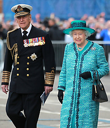 File photo dated 04/07/14 of Queen Elizabeth II and the Duke of Edinburgh at the formal naming ceremony for HMS Queen Elizabeth in Rosyth Dockyard, Fife. The Duke of Edinburgh was the longest-serving consort in British history. Philip overtook the record of 57 years and 70 days set by Queen Charlotte, wife of King George III, on April 18 2009. Issue date: Friday April 4, 2021.