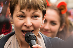 """Westminster, London, July 14th 2015. Hundreds of animal rights activists and members of hunt saboteur groups gather outside Parliament to """"Fight For THe Fox"""" as Paliament discusses an amendment to the bill outlawing fox hunting that could see the sport return to the British countryside. PICTURED: The Green Party's Caroline Lucas addreses the crowd."""