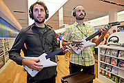 """Oct. 22, 2009 -- SCOTTSDALE, AZ:  WILL ROGGE, left, and ANDREW LAPUTKA, both from Los Angeles, play the game """"Beatles Rock Band"""" on a Microsoft X-Box 360 at the new Microsoft store in Scottsdale, AZ, Thursday. Microsoft's first retail store opened in Fashion Square Mall in Scottsdale, AZ, Thursday. Microsoft's first foray into retail is widely considered to be a shot across the bows of Apple computers. The store's design is similar to Apple stores and the new Microsoft store is between two Apple stores, one in an upscale shopping mall five miles north of the Microsoft store, the other  in an upscale shopping area about 5 miles west of the Microsoft store. Microsoft used the occasion to officially launch the newest version of Windows 7, the newest version of Windows, Microsoft's flagship product.    Photo by Jack Kurtz"""