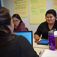 Allison Begay, 22, works with her classmates on their group project. Begay is one of several students working within the new Bachelor Degree program offered  University of New Mexico-Gallup.