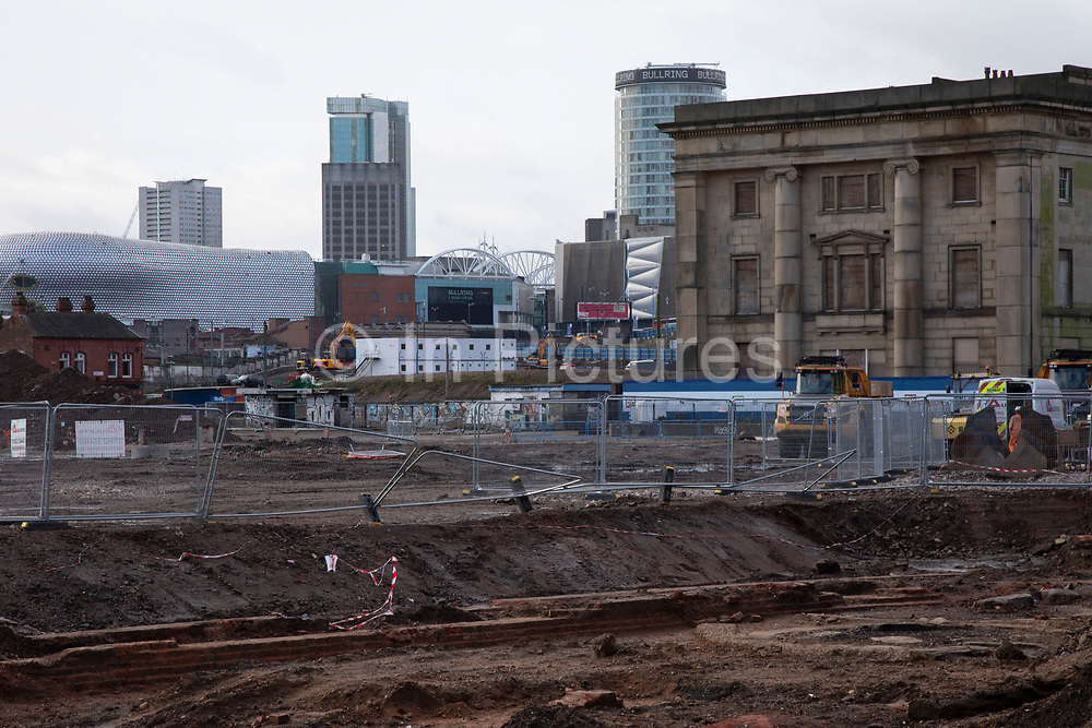 Construction site for the HS2 mainline station at Curzon Street looking towards the iconic Rotunda on 13th February 2020 in Birmingham, England, United Kingdom. The Curzon Street Masterplan covers a 141 hectare area of regeneration, focussed on HS2 Curzon Street station in Birmingham city centre, combined with approximately 700 million in investment into the surrounding area including new homes and commercial developments. High Speed 2 is a partly planned high speed railway in the United Kingdom with its first phase in the early stages of construction, the second phase is yet to receive full approval and the third is subject to merging with Northern Powerhouse Rail, a separate project.