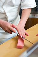 Sushi chef Masatoshi Yoshino is cutting ohtoro (fatty tuna) at his restaurant Yoshino Sushi Honten, Tokyo, Japan