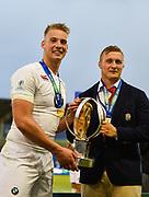 England fly-half Harry Mallinder and Jack Walker hold the trophy after the World Rugby U20 Championship Final   match England U20 -V- Ireland U20 at The AJ Bell Stadium, Salford, Greater Manchester, England onSaturday, June 25, 2016. (Steve Flynn/Image of Sport)