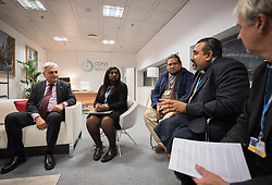 9 December 2019, Madrid, Spain: Religious leaders from a variety of faiths meet to hand over an interfaith declaration to Ovais Sarmad, deputy executive secretary of the UNFCCC, at COP25. Here, Rev. James Bhagwan from the Pacific Conference of Churches (right).