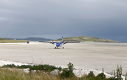 Barra Airport is a short-runway airport situated in the wide shallow bay of Traigh Mhòr at the north tip of the island of Barra in the Outer Hebrides, Scotland. Barra is now the only beach airport anywhere in the world to be used for scheduled airline services. Loganair Twin Otter taxiing towards terminal building. (c) Stephen Lawson   Edinburgh Elite media