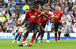 Manchester United's Paul Pogba scores his side's second goal of the game from the penalty spot during the Premier League match at the AMEX Stadium, Brighton.