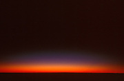 The afterglow of sunset on the horizon.