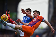 Portsmouth Midfielder, Gareth Evans (26) and Northampton Town Defender, David Buchanan (3) compete for the ball during the EFL Sky Bet League 1 match between Portsmouth and Northampton Town at Fratton Park, Portsmouth, England on 30 December 2017. Photo by Adam Rivers.
