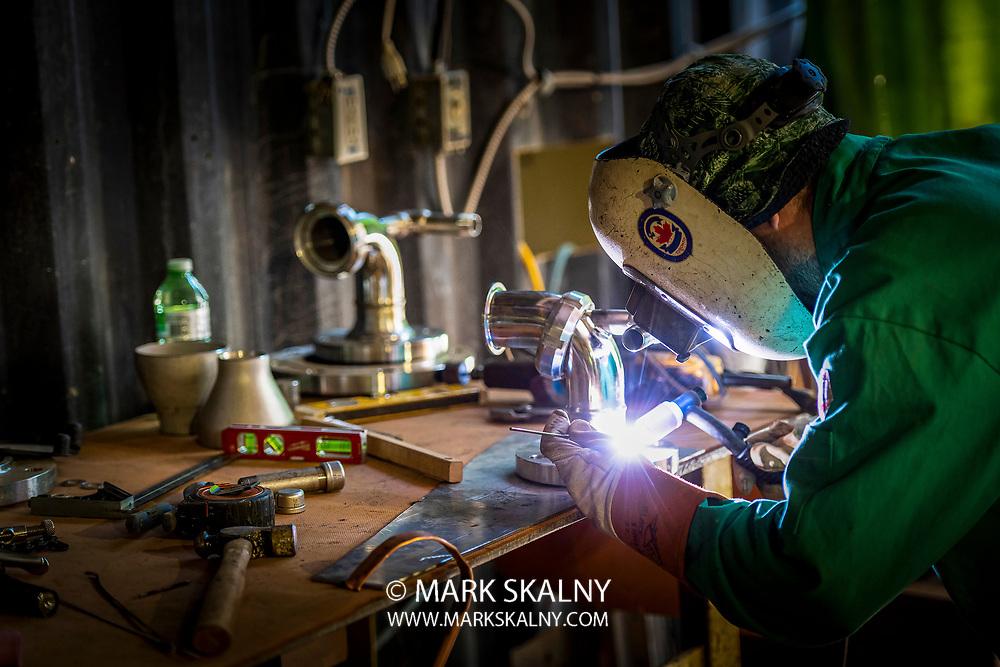 Centuri Canada TIG Welder working on some detail welding.