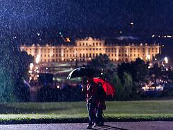 30.05.2013, Schoenbrunner Schlosspark, Wien, AUT, Sommernachtskonzert der Wiener Philharmoniker, im Bild Zuschauer mit Regenschirm vor Schloss Schoenbrunn // Spectator with Umbrella during summer night concert of the viennese philharmonic orchestra, chateau park Schoenbrunn, Vienna, Austria on 2013/05/30, EXPA Pictures © 2013, PhotoCredit: EXPA/ Michael Gruber