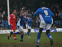 Aaron Downes of Chesterfield (centre) wheels away after scoring with a header.