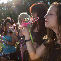Girls blow soap bubbles during a soap bubble day in a public park in Budapest, Hungary on August 19, 2012. ATTILA VOLGYI