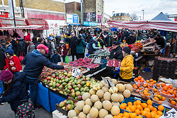 London, UK. 9th February, 2019. A fruit stall in Ridley Road market in Dalston.