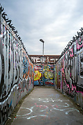 A bridge over a railway line off Brick Lane covered in graffiti in London, United Kingdom.