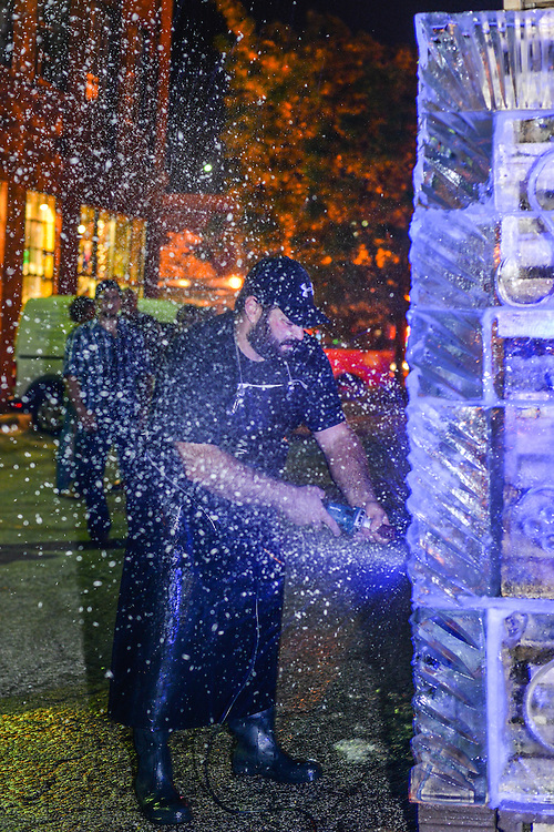 Preparing the Fire and Ice Tower to be lit at the NorthSide district during Akron Art Prize 2014.
