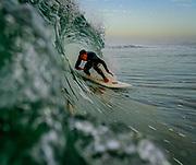 Man Surfing a Barrel Wave