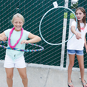 Lawton Mayo, 9, left, and Shelby Miller, 11, hula hoop Thursday August 7, 2014 during The Shrip-A-Roo at Buddy's Crab House & Oyster Bar in Wrightsville Beach, N.C.  (Jason A. Frizzelle)
