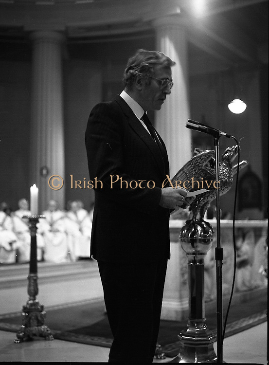 Funeral Of Sean McBride.   (R71)..1988..18.01.1988..01.18.1988..18th January 1988..Today saw the Funeral of Seán McBride.Seán MacBride was an Irish government minister, a prominent international politician and a former Chief of Staff of the IRA. His funeral took place from the Pro-Cathedral in Dublin to the family plot in Glasnevin Cemetery, Dublin.The Chief mourners were Tiernan McBride,son, Anna White,daughter and Declan White, son in law...Image shows Tiernan McBride reading a lesson during the funeral for his father,Seán.