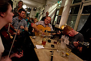 Jamming in The Harrison, Kings Cross. At the moment there is a quiet musical revolution going on in London - the city that has spawned so many important styles and movements, now has a bubbling experimental blues and folk scene, with many musicians independently recording and distributing their own albums through crowdfunding and social media without the need of large record labels and restrictive contracts. They play week in week out in a pleathora of small, independent, underground and makeshoft venues that have sprung up such as Jamboree and 14 Bacon Street.