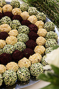 a platter of Cream cheese balls rolled in spices and herbs
