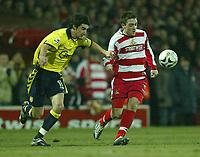 Photo: Aidan Ellis.<br /> Doncaster Rovers v Aston Villa. Carling Cup. 29/11/2005.<br /> Doncaster's Paul Heffernan holds off the challenge from Villa's Liam Ridgewell