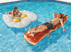 """June 6, 2017 - inconnu - Egg and bacon lovers can now start every morning in their holiday pool with their favourite breakfast.A set of two inflatable floats in the shape of two fried eggs, sunny-side up, and a strip of bacon provide the perfect surface to relax on while soaking up the morning sun. The $80 USD / €70 Euros / £62 GBP inflatables are constructed with.25mm thick vinyl and support up to 90 kilos / 200 lbs. each. They are sold by US oinline retailer Hammacher Schlemmer.A spokesman joke that the thick vinyl """"ensures both non-runny surfaces as well as crispy resilience. """" # DES MATELAS POUR LES FANS D'OEUFS BACON (Credit Image: © Visual via ZUMA Press)"""