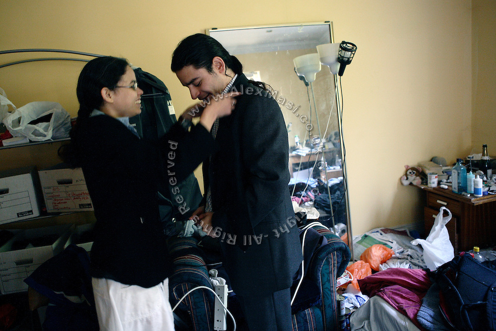 Kitty, 24, (left) from Trinidad, is adjusting her boyfriend's tie, Josh, 26, (right) form North London minutes before leaving the Ingram Avenue mansion to face the owner's eviction order in Court on Thursday, Oct. 11, 2007, in Hampstead, London, England. The 22-room mansion was last sold for UK£ 3.9M in 2002 and is now awaiting planning permissions to be demolished. Two new houses will soon be taking its place. Million Dollar Squatters is a documentary project in the lives of a peculiar group of squatters residing in three multi-million mansions in one of the classiest residential neighbourhoods of London, Hampstead Garden. The squatters' enthusiasm, their constant efforts to look after what has become their home, their ingenuity and adventurous spirit have all inspired me throughout the days and nights spent at their side. Between the fantasy world of exclusive Britain and the reality of squatting in London, I have been a witness to their unique story. While more than 100.000 properties in London still lay empty to this day, squatting provides a valid, and lawful alternative to paying Europe's most expensive rent prices, as well as offering the challenge of an adventurous lifestyle in the capital.