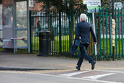 © Licensed to London News Pictures. 11/03/2020. London, UK. Shadow Chancellor, John McDonnell runs for a bus as he heads to Parliament from his west London home this morning. Later today, the new Chancellor of the Exchequer, Rishi Sunak will present his first budget to Parliament. Photo credit: Vickie Flores/LNP
