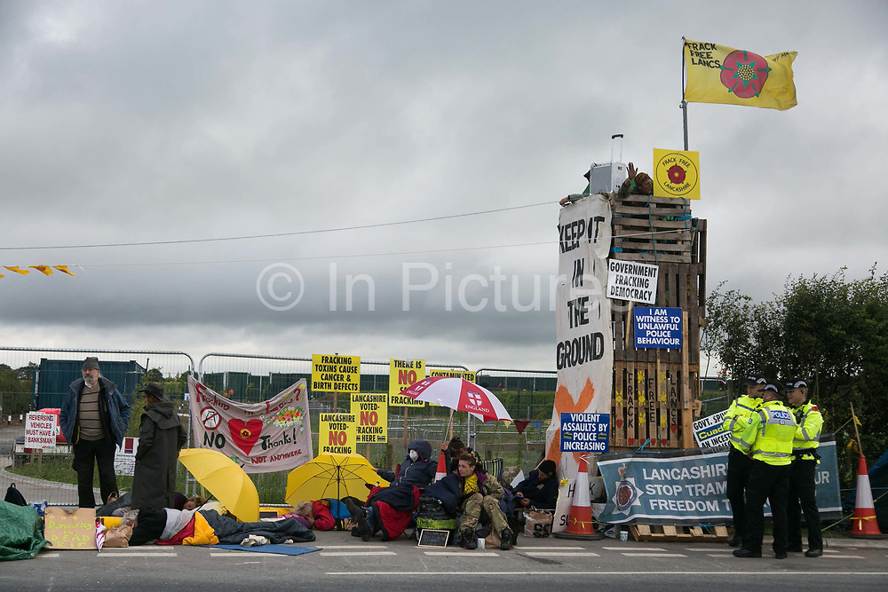 12 local activists locked themselves in specially made arm tubes to block the entrance to Quadrillas drill site in New Preston Road, July 03 2017, Lancashire, United Kingdom. Protestors agains fracking blocking the gates. The 13 activists included 3 councillors; Julie Brickles, Miranda Cox and Gina Dowding and Nick Danby, Martin Porter, Jeanette Porter,  Michelle Martin, Louise Robinson,<br /> Alana McCullough, Nick Sheldrick, Cath Robinson, Barbara Cookson, Dan Huxley-Blyth. The blockade is a repsonse to the emmidiate drilling for shale gas, fracking, by the fracking company Quadrilla. Lancashire voted against permitting fracking but was over ruled by the conservative central Government. All the activists have been active in the struggle against fracking for years but this is their first direct action of peacefull protesting. Fracking is a highly contested way of extracting gas, it is risky to extract and damaging to the environment and is banned in parts of Europe . Lancashire has in the past experienced earth quakes blamed on fracking.
