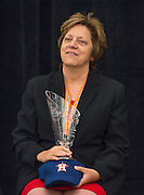 Houston Astros Senior Vice President for Community Relations Meg Vaillancourt sits with a Hall of Fame trophy during the Houston ISD Partnership Appreciation breakfast at Kingdom Builders, October 25, 2013.