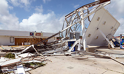 September 11, 2017 - Naples, Florida, U.S. - A Mobil gas station on US 41 in Naples shows damage from Hurricane Irma Monday. (Credit Image: © Lannis Waters/The Palm Beach Post via ZUMA Wire)