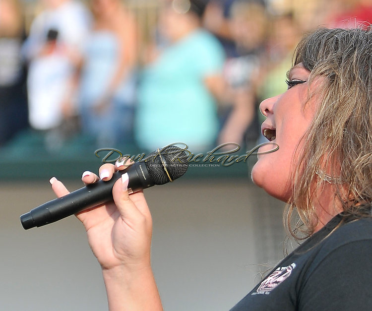 Kiki sings the National Anthem before a Frontier League baseball game featuring the Lake Erie Crushers at All Pro Freight Stadium in Avon, Ohio on July 28, 2011.