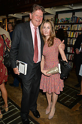 SIR JOHN MADEJSKI and EMMA ASH at a party to celebrate the publication of Stanley I Resume by Stanley Johnson at the Daunt Bookshop, Marylebone High Street, London on 23rd September 2014.